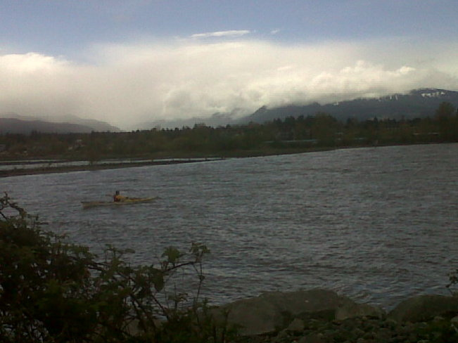 kayaking under clouds. Comox Valley, British Columbia Canada