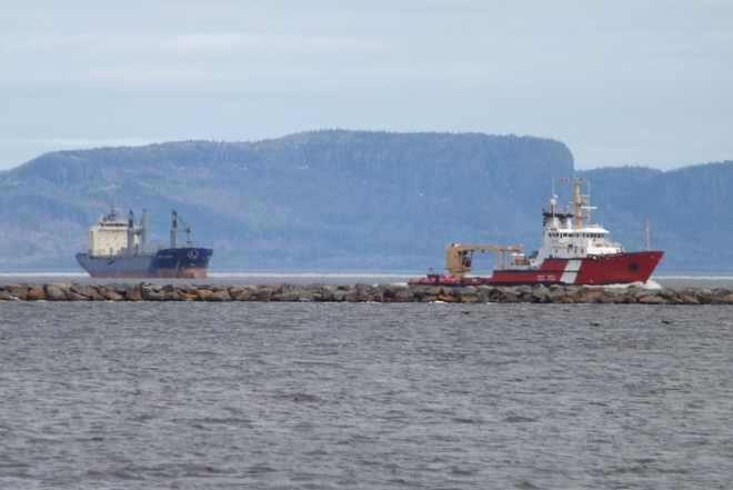 CANADA COAST GUARD WITH FEDERAL MIRAMICHI IN BACKGROUND Thunder Bay, Ontario Canada