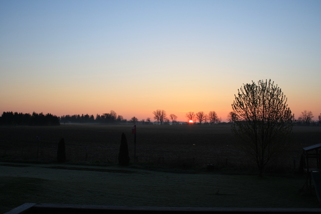 Sun rise over the farm field Nilestown, ON