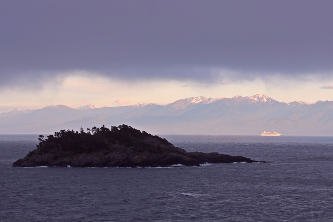 cruise ship leaving Ogden point - overlooking secretary island. Silver Spray Drive, Sooke, BC, Canada