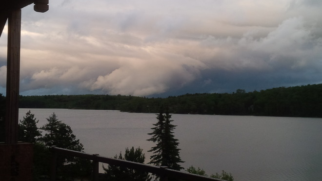 dark funnel like clouds over Raft Lake Raft Lake Sudbury, Ontario