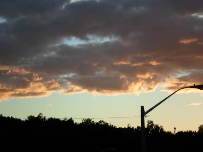 Dark Clouds/Clouds Lite up by Sun/ Elliot Lake, Ontario Canada