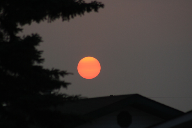Sunset in the smoky haze and the next day a clearing shower Tofield, AB