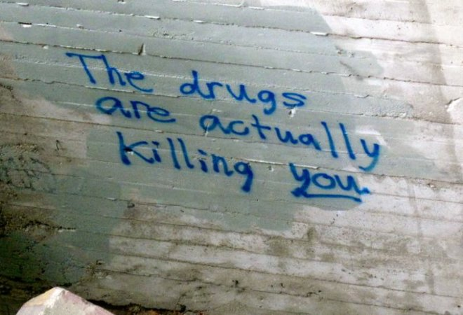 Graffiti wisdom under a bridge. Saskatoon, SK