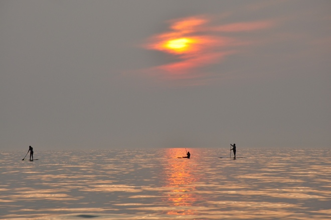 paddle boarding at sunset Sauble Beach, ON