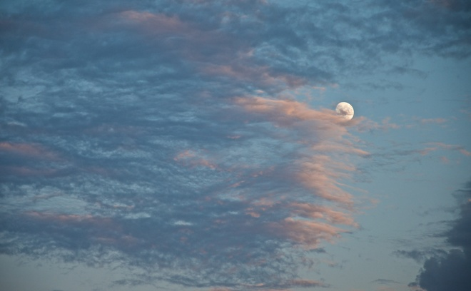 Moon Emerges from Ragged Sunset Clouds Edmonton, AB