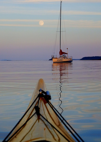 Almost a full moon, my kayak and an anchored sailboat 3844 Marine Drive, Royston, BC V0R 2V0, Canada