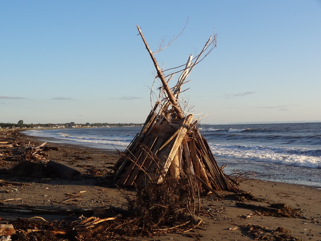 Preparing for a bonfire and after sunrise. Beresford, NB
