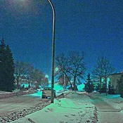Street lights,cold and snow, and deserted sidewalks