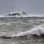 Gull Rock Lighthouse Battered by Heavy Seas