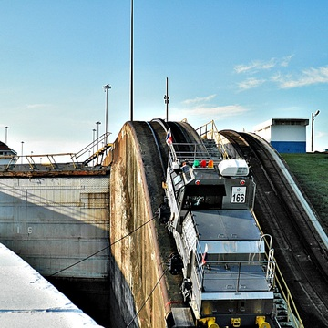 Locking through the Panama Canal Puled by Tender