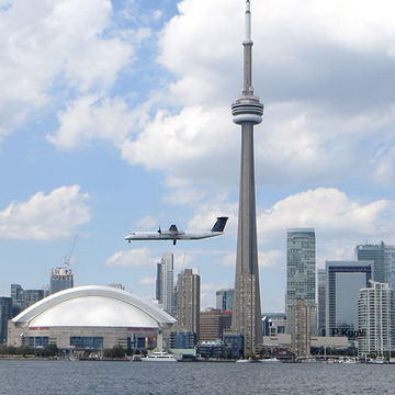 Toronto skyline and airplane from harbour