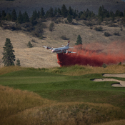 Heroic flying while fighting a wildfire in dry weather near Predator Ridge BC