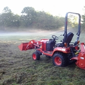Tilling the garden on a misty fall morning