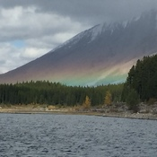 Mountain side rainbow