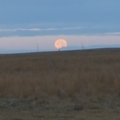 full moon going down