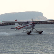 float plane coming into its landing