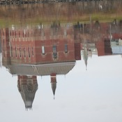Reflection of city hall in Fredericton.