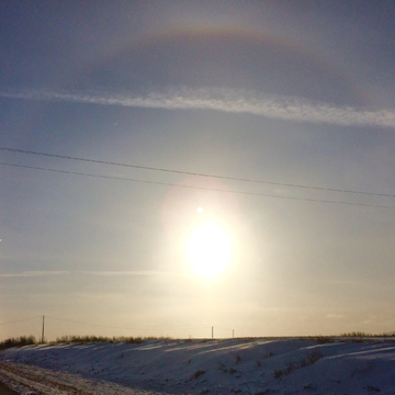 Second photo of sun dog taken a couple of seconds later shows the dot moved.