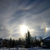 circle rainbow around the sun