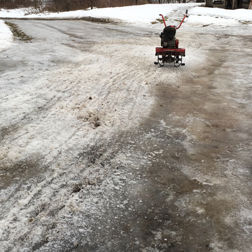Rototilling my icy driveway.