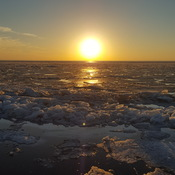 sunset over somewhat frozen lake erie