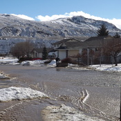 Snow melt in Ashcroft. Our street was like a river.