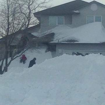snow drifts as high as the roofs