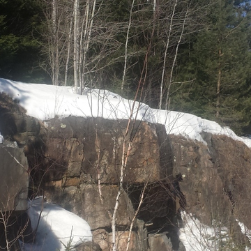 Granite with snow melting