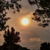 A Sun begins to Set Changes in Colors occur in the Clouds!