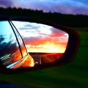 Sunset through car mirror