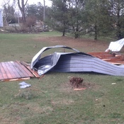 Pole barn shed on my front lawn from microburst