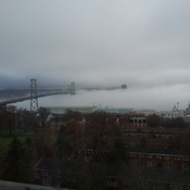 Fog moving under the Macdonald Bridge in Halifax N.S