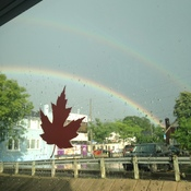 Double rainbow with maple leaf