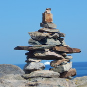 Inuksuk and iceburg