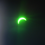 eclipse through welding goggles