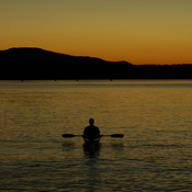 Kayaker admires sunset