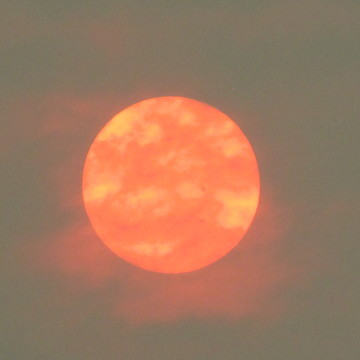 smoke-covered sun