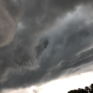 Storm clouds above our house
