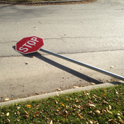 Wind blown down stop sign