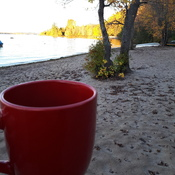Pumkin spice coffee on an October morning on the beach