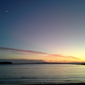 Sunset, low tide and moon rising
