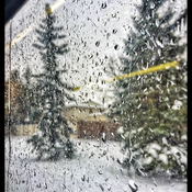 Through the LRT window: Rain ON the snow !