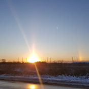 Beautiful sun rise with sun dogs