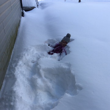 Attempting snow angels
