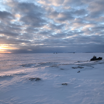 Ice fishing shacks at sunset on Lake Nipissing