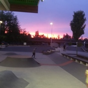 sunset at a skatepark.