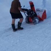 Husband enjoying the warm weather snow blowing a day after the storm.