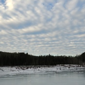 Beaver pond with clouds