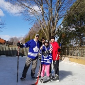 Enjoying the sunshine on the backyard rink